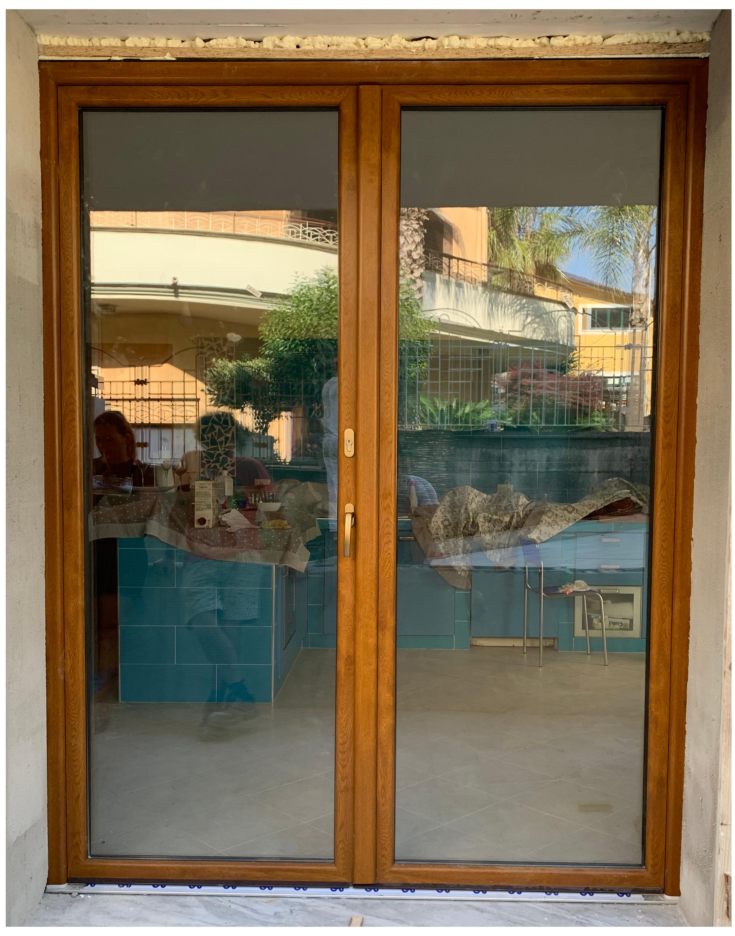 infissi in legno porta finestra a Salerno